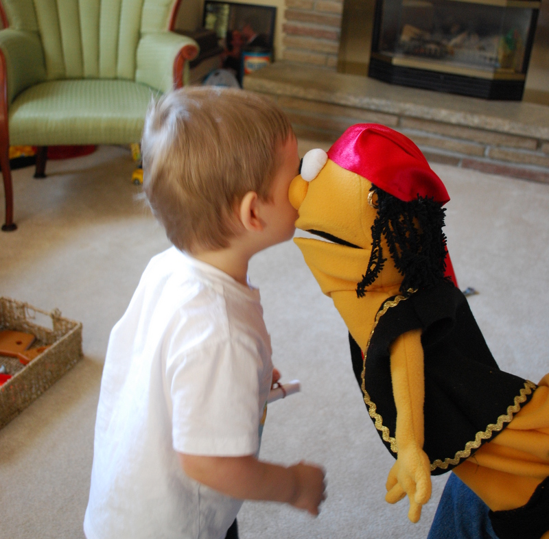 Pirate Pete whispering the first clue to Onetime