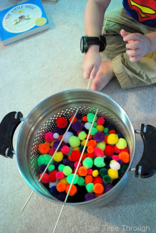 Putting Sticks Into PomPom Game