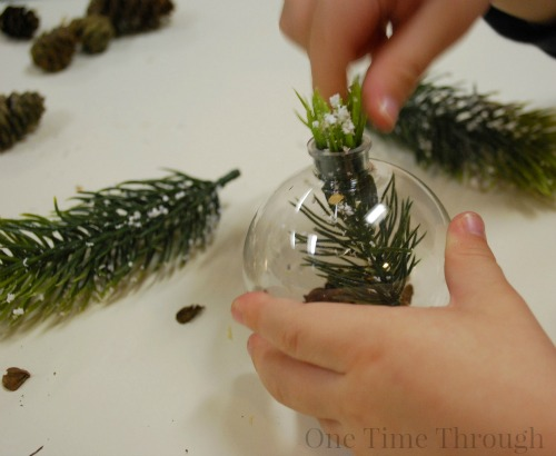 Putting Pine Sprigs in Pine Ornaments