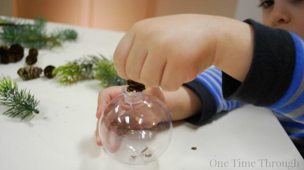 Putting Pinecones in Pine Ornament