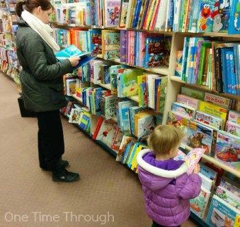 Child Reading Like Mommy