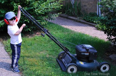 Preschooler pushing lawnmower