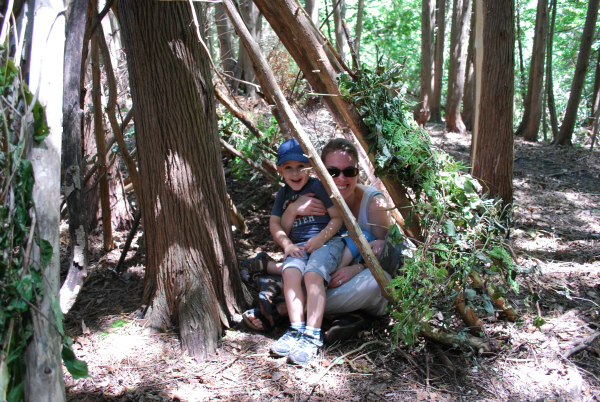 adult and child in tree fort